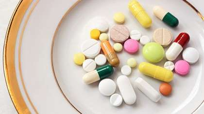 Pills in a soup bowl - The Cause of Chronic Disease – A Poisonous Soup