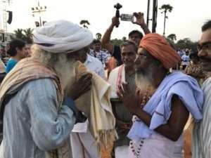 Sadhguru interacts with a Sadhu at Kanyakumari