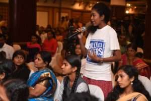 A student interacts with Sadhguru at the event for Rally for Rivers