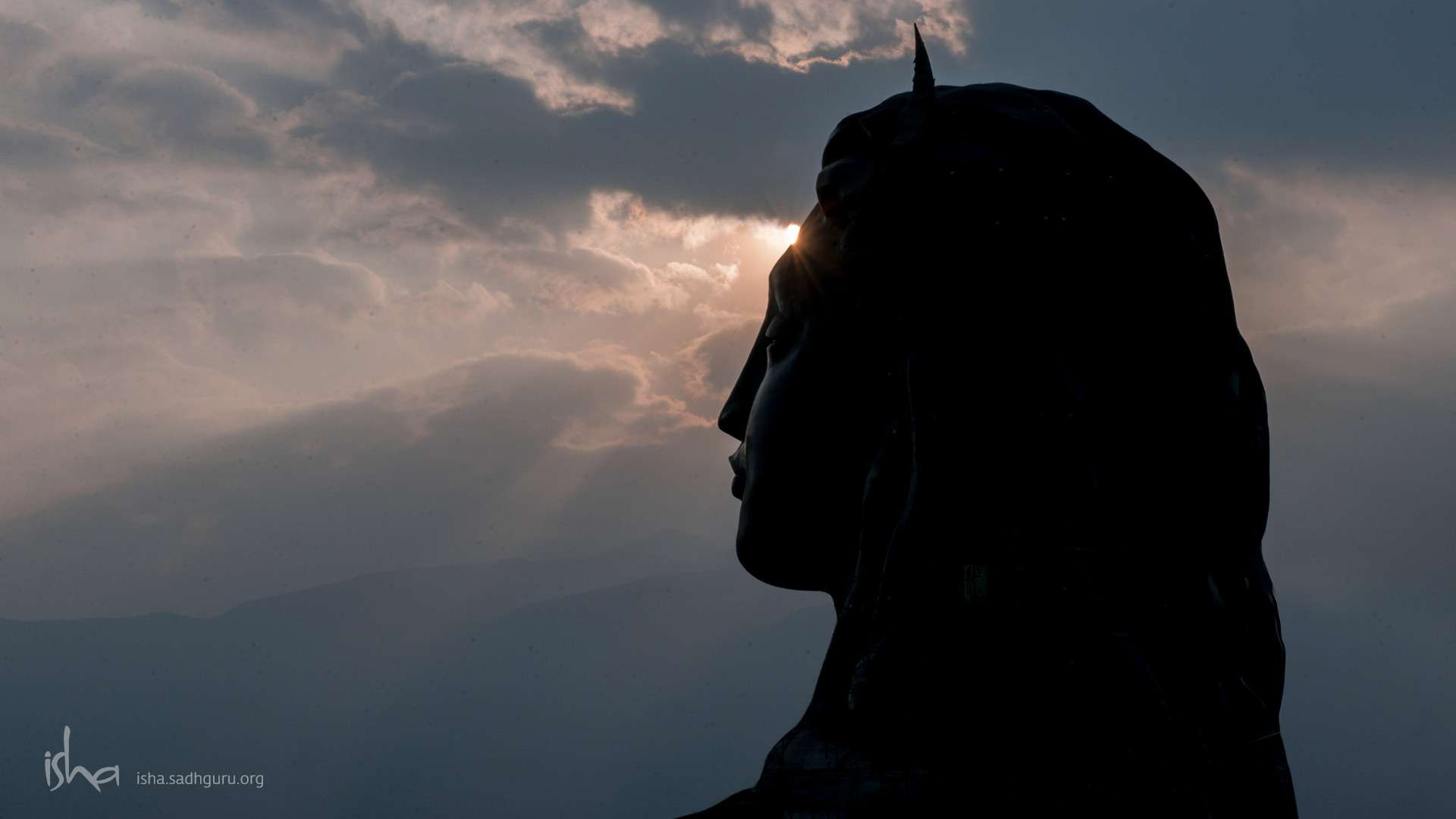 Wallpaper of Shiva - The Adiyogi with setting Sun