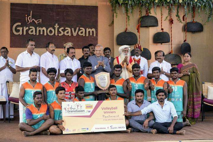 The winning team in Men's volleyball, Poolavari pose with their prize at the Isha Gramotsavam 2018